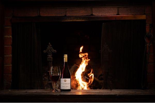 Pinot Noir Bottle in front of fire